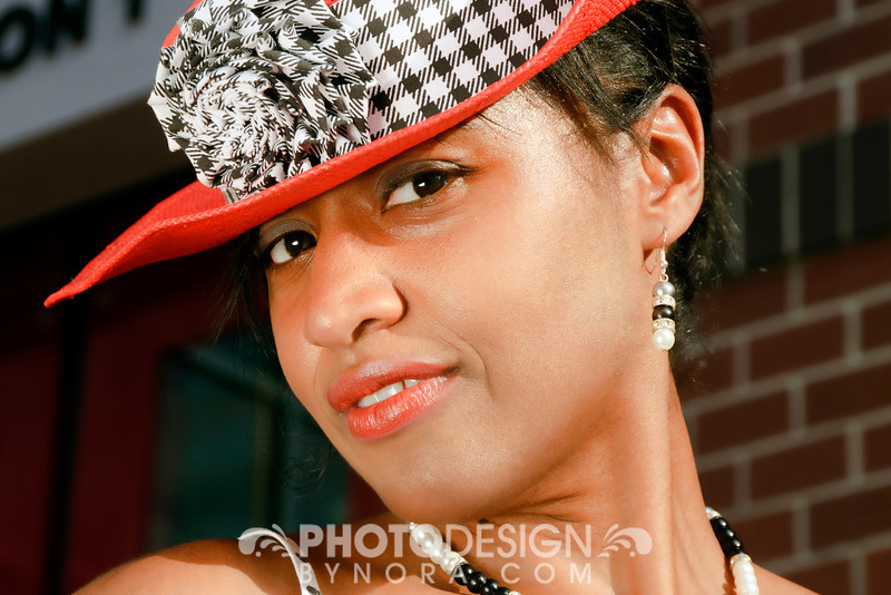 Model Lissette in Fashionable Hat with Flower